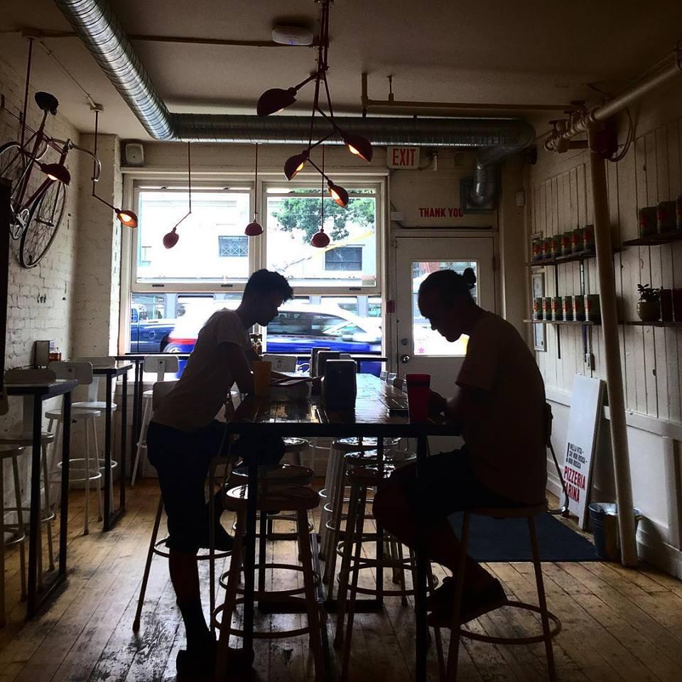 Inside decor of Pizzeria Farina Vancouver pizza store.